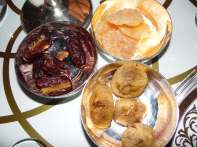 Customary dates, figs, oranges